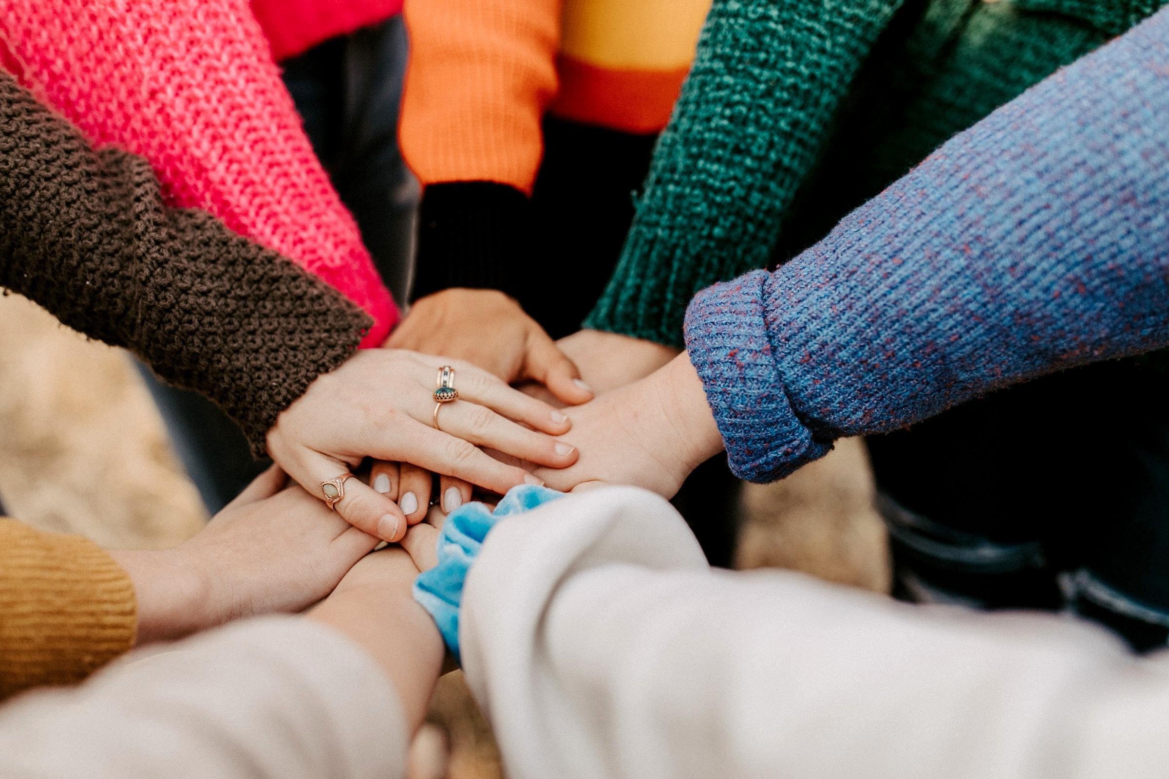 team holding hands